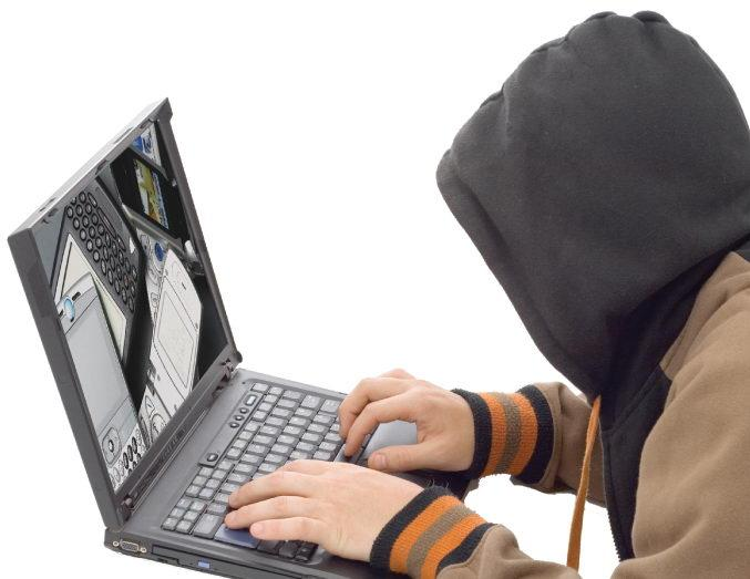 Hacker clujean, dat în urmărire națională, prins de polițiști. A fost dus la închisoare