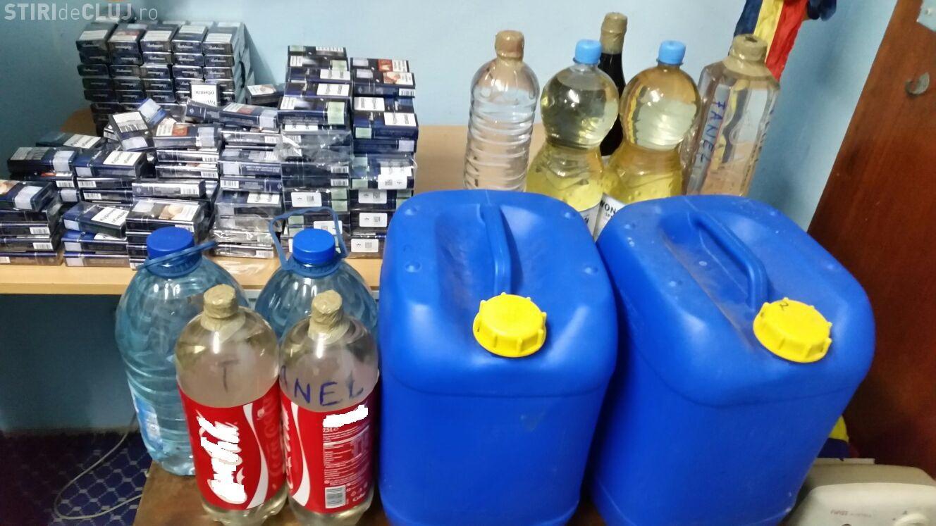 Mii de țigarete și zeci de litri de alcool, confiscate de polițiști la Cluj FOTO