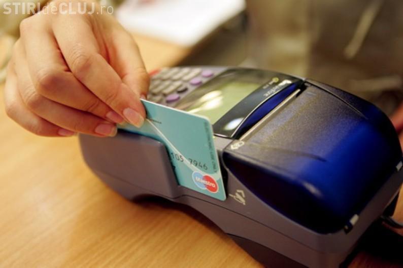 ANAF cere să aibă acces la plăţile cu cardul pe care românii le fac la magazine