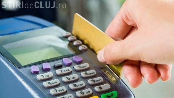 Românii vor putea scoate bani de pe card direct din magazine, începând cu anul viitor