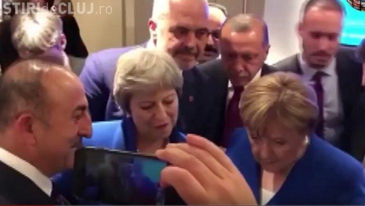 Angela Merkel, Theresa May și Erdogan, surprinși în timp ce se uită pe telefon la meciul Anglia-Croația VIDEO