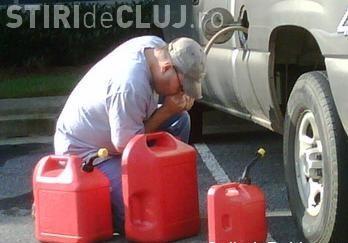 Clujean prins de polițiști în timp ce fura benzină dintr-o mașină în Mănăștur