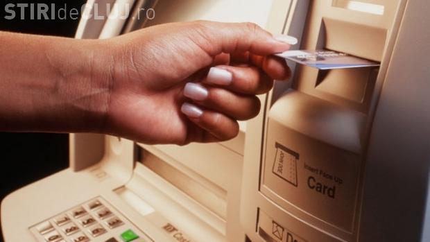 Ce comisioane practică băncile la retragerea banilor