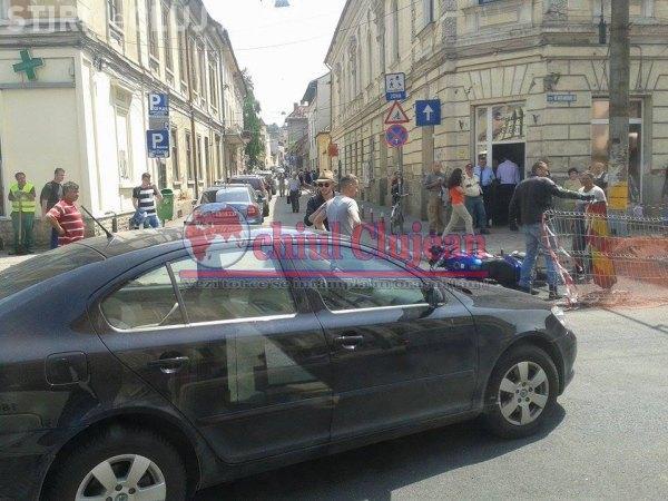 Motociclist lovit de un șofer în centrul Clujului FOTO