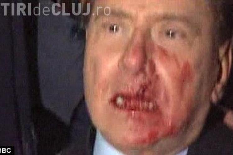 Berlusconi, lovit cu pumnul in fata