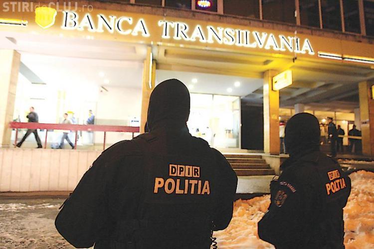 Cei doi suspecti in cazul jafului de la Banca Transilvania din Cluj  raman in arest