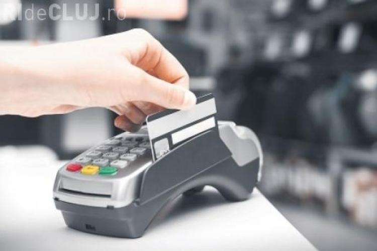 A fost promulgată legea prin care instituţiile publice sunt obligate să accepte şi plata cu cardul