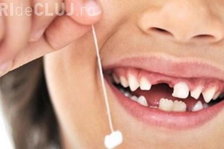 Părinţii nu trebuie să arunce dinţii de lapte ai copiilor! Cum i-ar putea ajuta