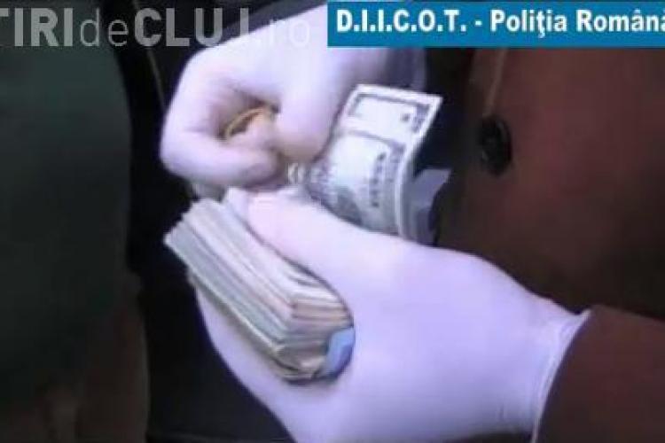O retea care a pus si la Cluj in circulatie dolari falsi a fost anihilata de procurorii DIICOT - VIDEO