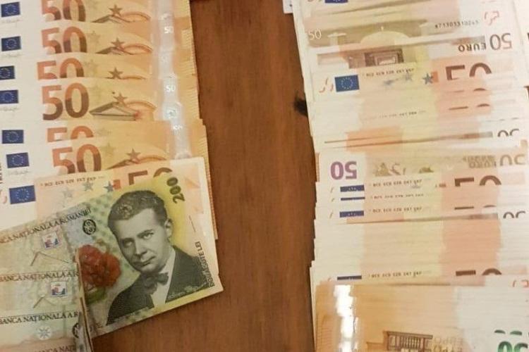 Spărgător de locuințe, prins de polițiștii clujeni după ce a furat aproape 10.000 de euro. Banii au fost recuperați FOTO