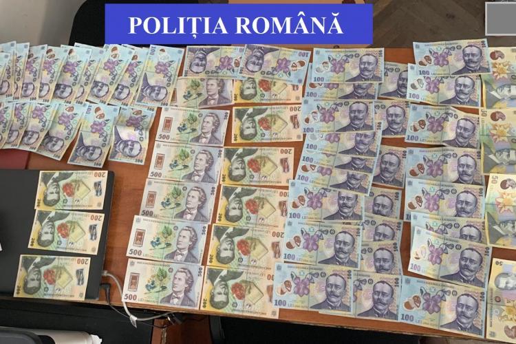 Escroci prinși de polițiști după ce au păcălit o clujeancă să le dea 60.000 de euro FOTO