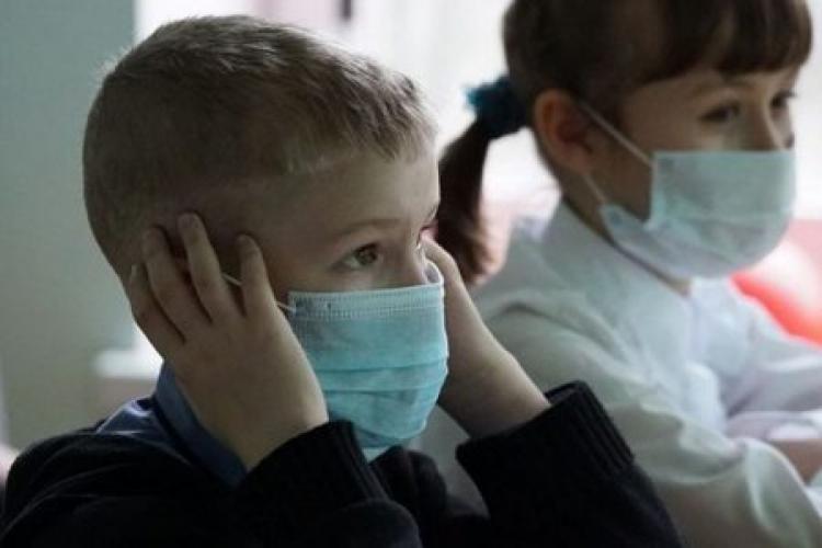 Două școli din Cluj sunt închise parțial din cauza gripei