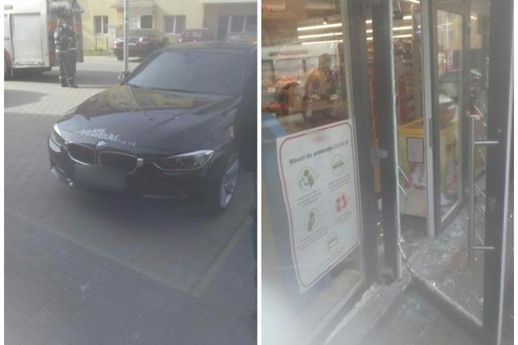 Accident la Florești! A intrat cu BMW-ul în ușa unui supermarket - FOTO