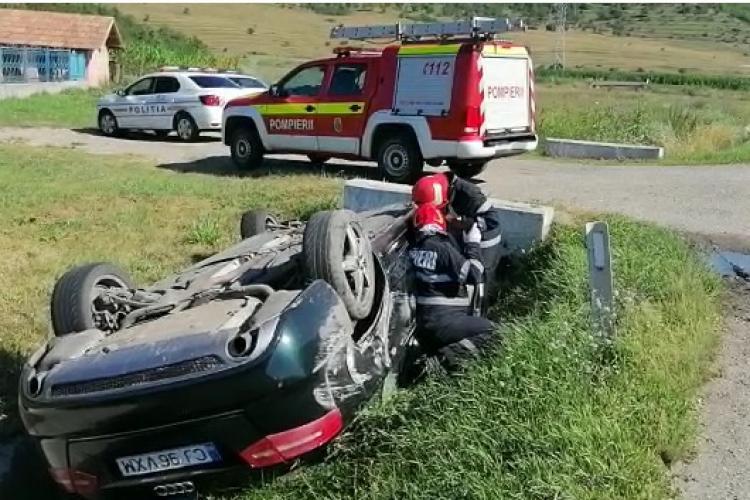 Accident cu trei mașini pe centura Apahida. Un autoturism a fost răsturnat complet FOTO