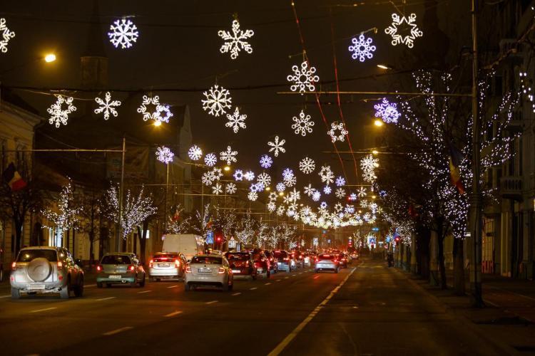 Care oraș e mai frumos decorat de Crăciun, Cluj-Napoca sau București? Votați cu un SHARE - FOTO