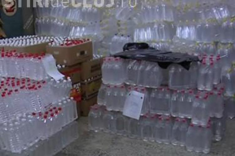 Culmea contrabandei! Doi clujeni vindeau in strada 9.000 de tigari si 120 de litri de alcool - VIDEO