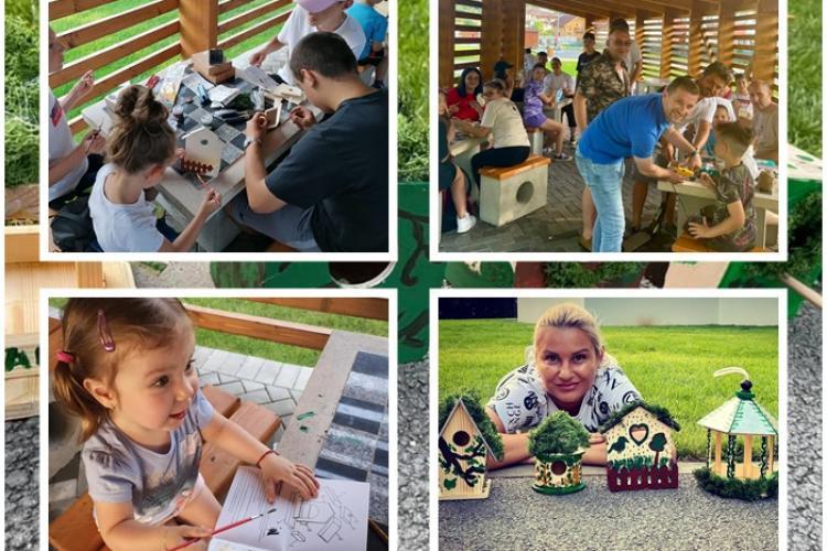 Copiii din Florești, ajutați de adulți, au construit 20 de căsuțe pentru păsări. Primarul Pivariu a dat și el o mână de ajutor - FOTO