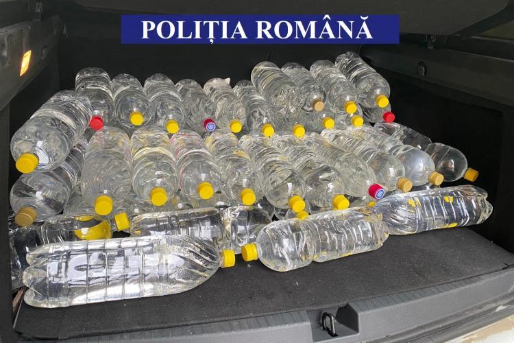 710 litri de alcool etilic, confiscați la Cluj de polițiștii de la Economic - FOTO