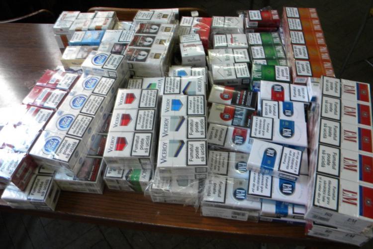 Cinci persoane cercetate la Cluj pentru trafic de tigari, alcool si legume-fructe!