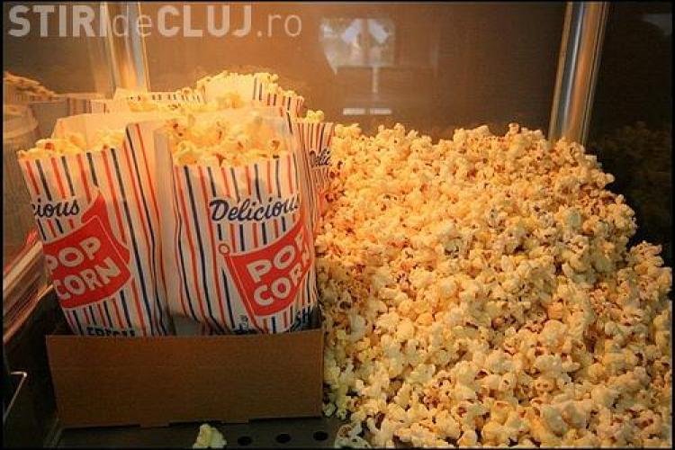 Nutritionistii din Marea Britanie militeaza pentru micsorarea portiilor de popcorn la cinema