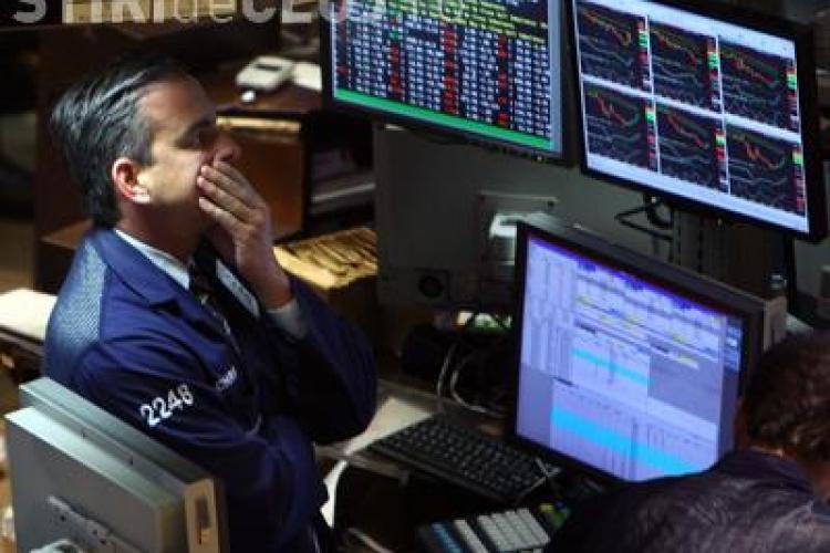 Bursele americane si europene se prabusesc, la anuntul ca economia SUA nu mai e stabila