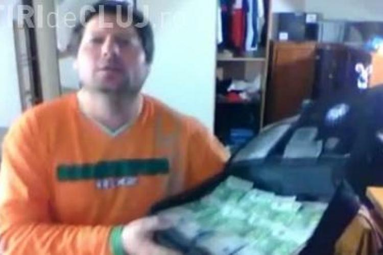 Un roman danseaza cu o valiza de bani, intr-un film postat pe YouTube VIDEO