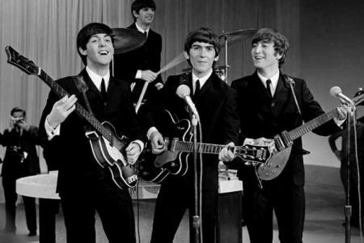 Vaticanul ii iarta pe Beatles pentru blasfemie