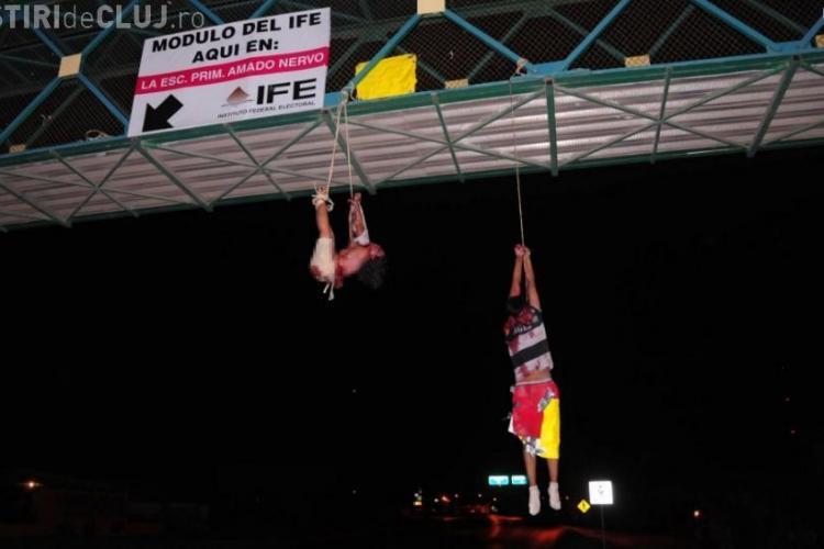 Ce patesc bloggerii in Mexic: Cuplu spintecat, torturat si atarnat de un pod pentru postari pe Twitter