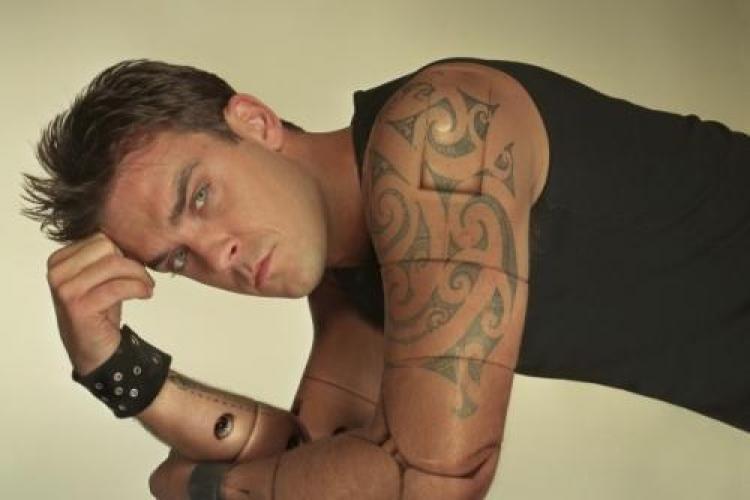 Robbie Williams a plecat din grupul Take That