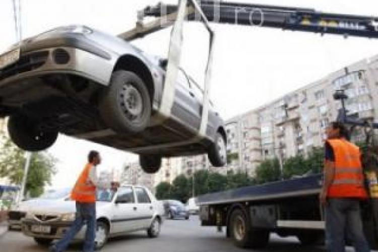 Masinile vor fi in continuare ridicate in Cluj-Napoca! Vezi ce as a scos din maneca Primaria