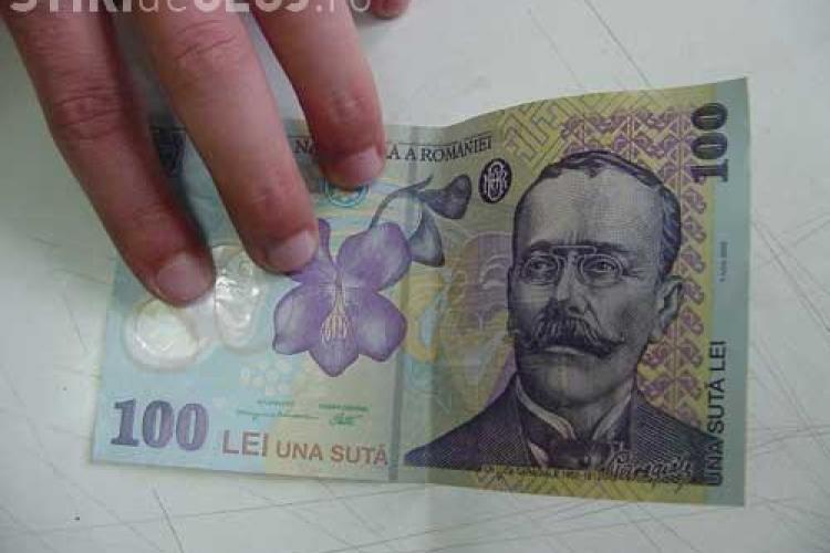 Bancnote de 100 de lei false, puse in circulatie la Cluj de o grupare din Pitesti