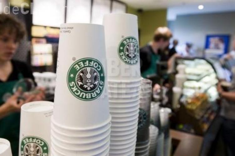 Lantul de cafenele Starbucks a fost dat in judecata de un client care s-a oparit
