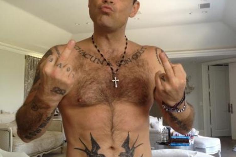 Robbie Williams devine tatic