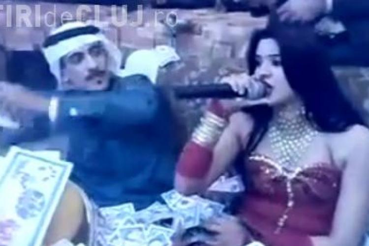 """Un print arab ingroapa in bani o cantareata: """"Aici se duc toti banii pe care ii dati pe benzina""""  VIDEO"""
