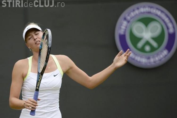 Imaginea zilei la Wimbledon! Şarapova înfășurată în prosoape FOTO