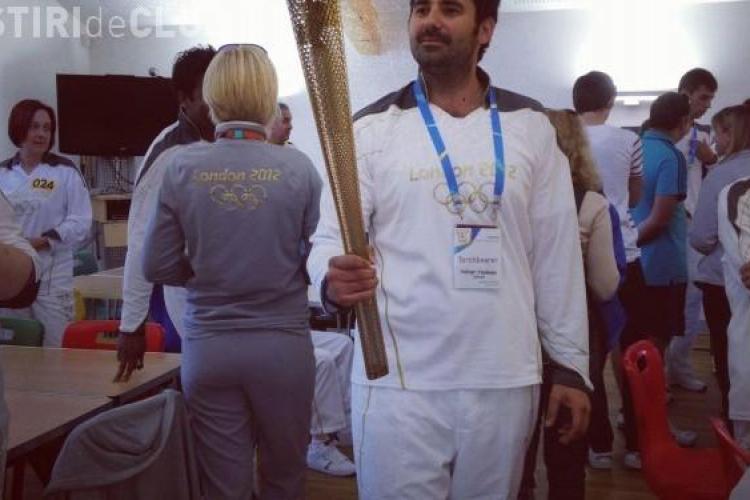 Adi Hadean preia azi torța olimpică, lângă Londra