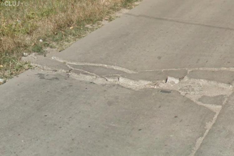 Clujenii de pe Valea Chintăului se plâng de craterele din drum. Ce răspuns a dat Emil Boc? - FOTO