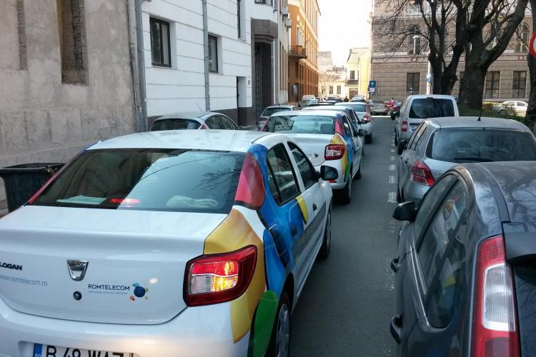 Cum blochează șoferii de la Romtelecom Cluj o stradă din centru - FOTO