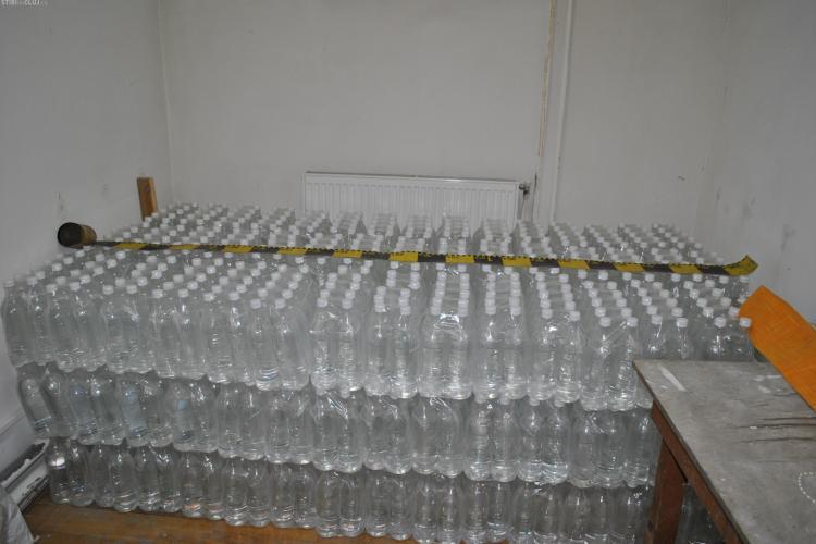 Cluj - Contrabandiști de alcool înarmați prinși de polițiști: 1.500 de litri de alcool, confiscaţi - VIDEO