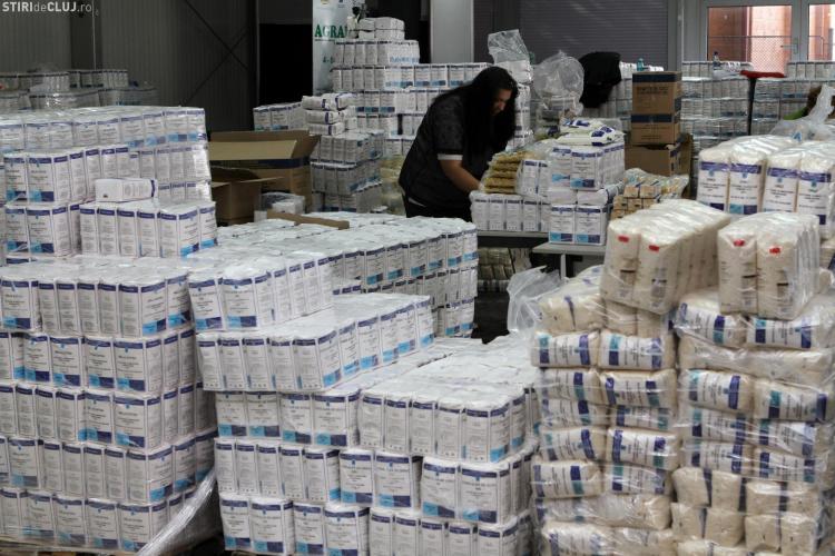 Primăria Cluj-Napoca distribuie pachetele cu alimente pentru persoanele defavorizate