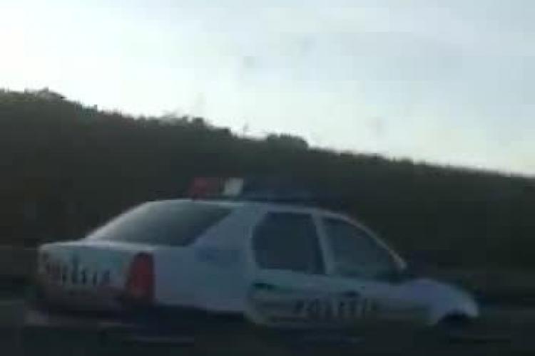 Mașina de Poliție circulă pe contrasens pe Autostrada Transilvania! Au pornit și girofarul ca șmecherii - FOTO