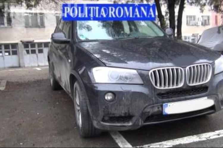 Percheziții la un hoț de mașini la Cluj. Încerca să vândă un BMW furat din Germania VIDEO