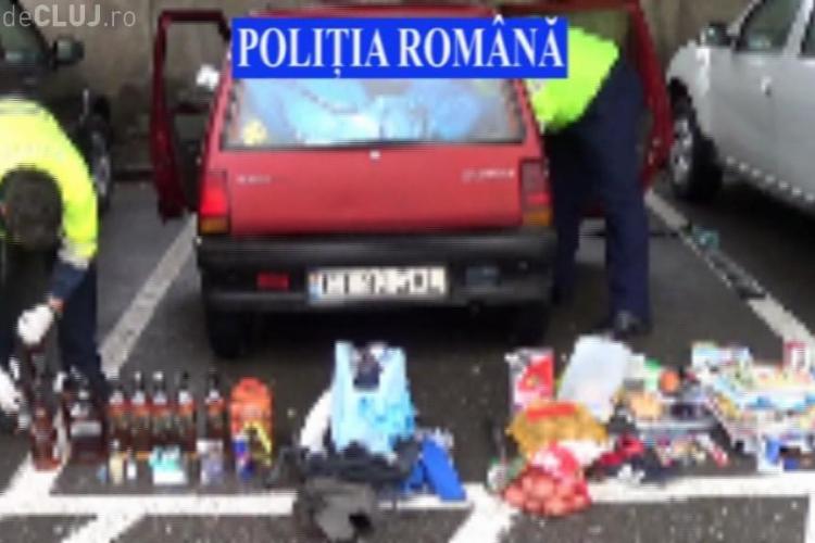 Cuplu de hoți, prinși la Cluj. Aveau portbagajul plin de bunuri VIDEO