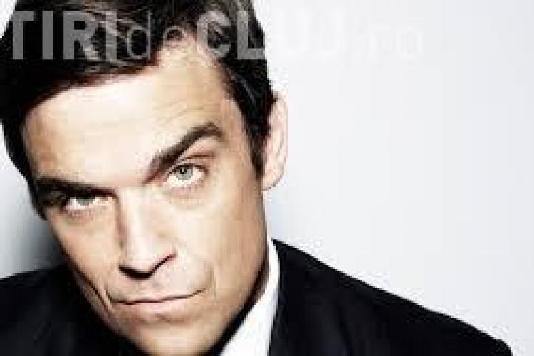 Robbie Williams le face o surpriză fanilor români