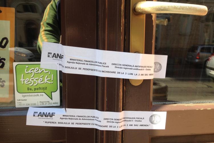 ANAF Cluj a închis magazinele din Centru care nu dau bonuri fiscale - FOTO