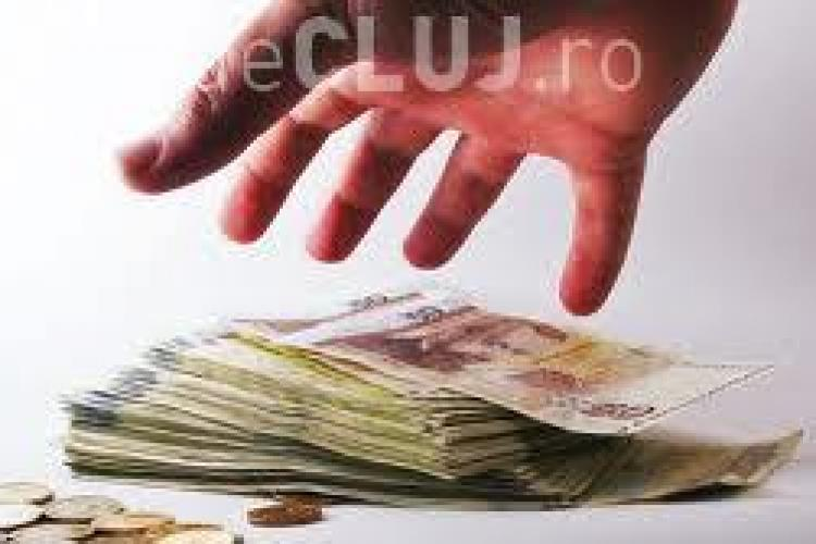 Clujeni prinși în flagrant încercând să obțină credit de 200.000 lei cu acte false. Au mai țepuit și alte bănci