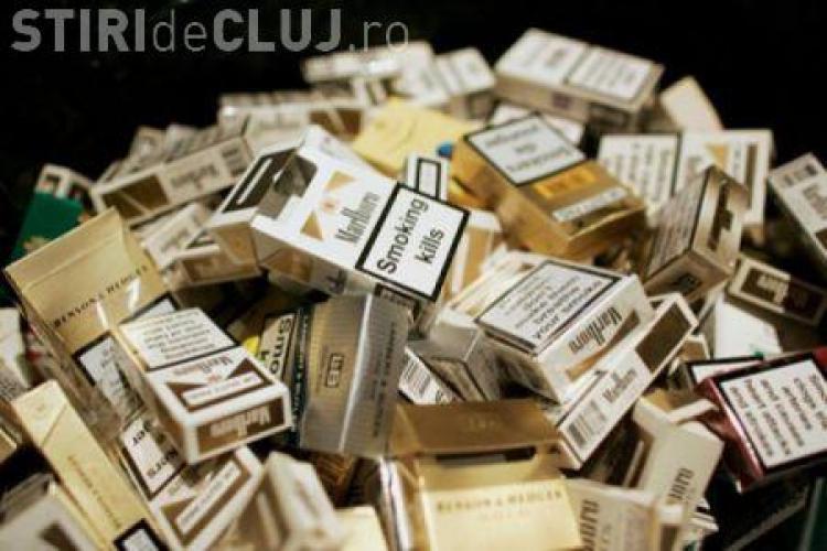 Contrabandist de țigări, prins pe tren la Cluj. Polițiștii au confiscat mii de țigarete